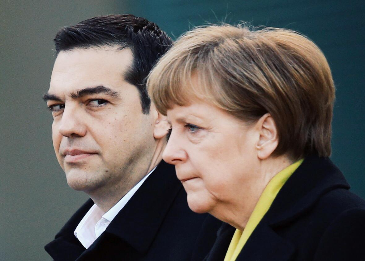 Greek Prime Minister Alexis Tsipras and German Chancellor Angela Merkel listen to their countries' national anthems upon Tsipras' arrival for talks at the Chancellery on March 23, 2015, in Berlin.
