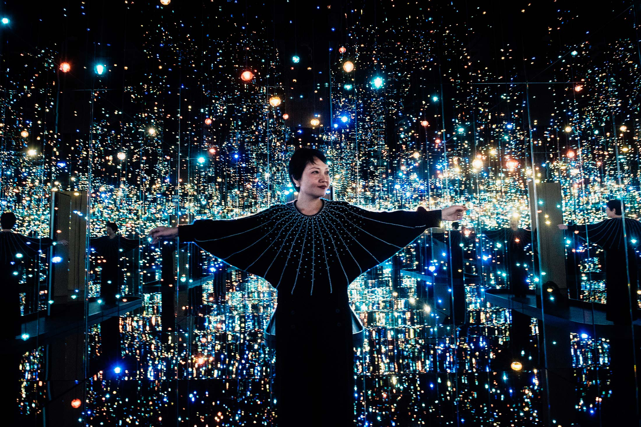 Yayoi Kusama's Infinity Mirrors exhibition curator Mika Yoshitake poses its the Souls of Millions of Light Years Away at the Hirshhorn Museum February 21, 2017 in Washington, DC.