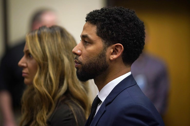 Jussie Smollett seen in profile in a courthouse.