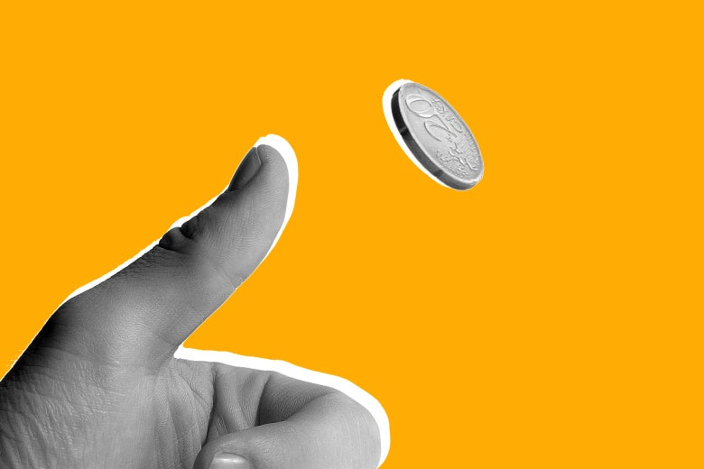 Hand flipping a coin.