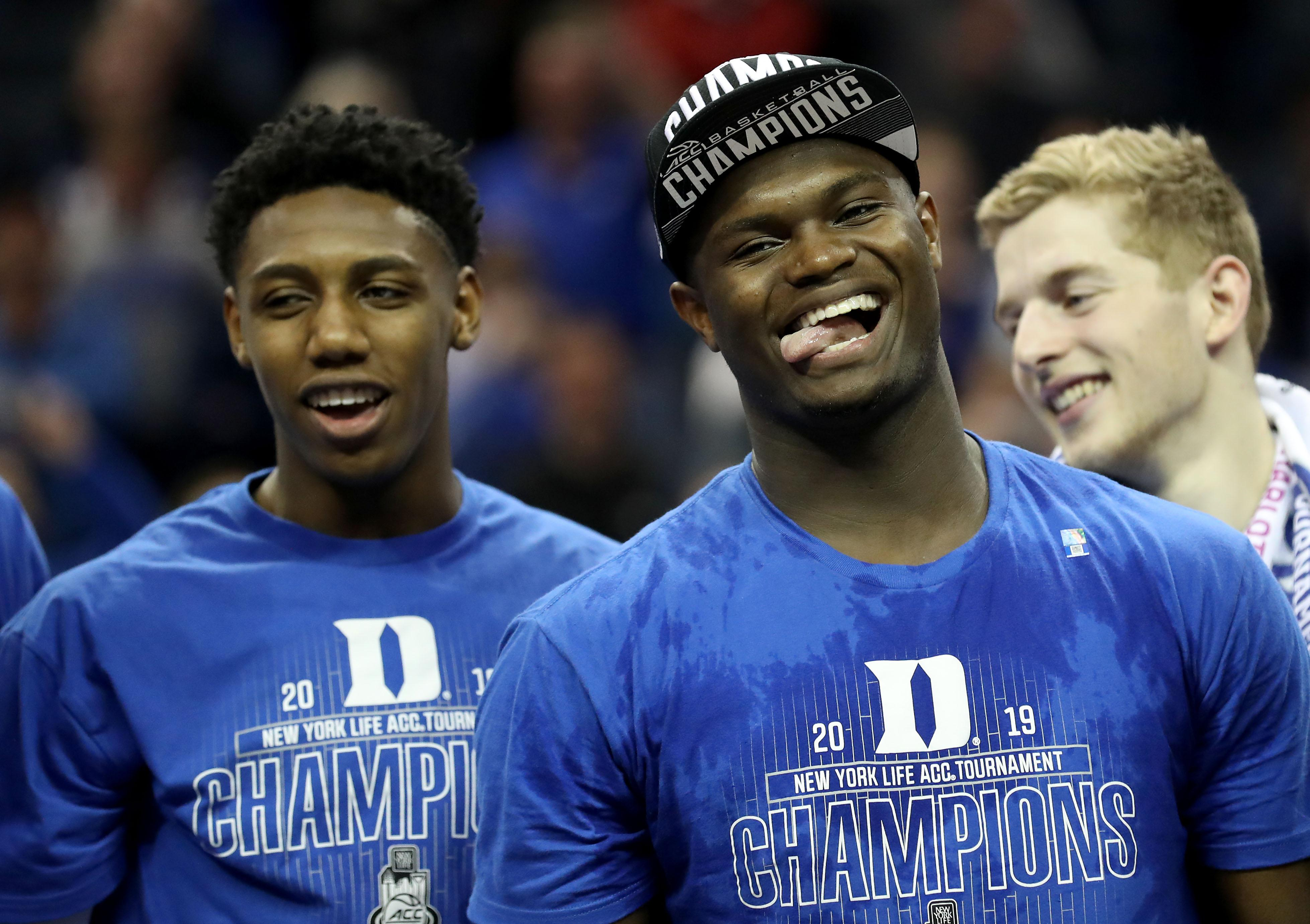 CHARLOTTE, NORTH CAROLINA - MARCH 16: Teammates RJ Barrett #5 and Zion Williamson #1 of the Duke Blue Devils react after defeating the Florida State Seminoles 73-63 in the championship game of the 2019 Men's ACC Basketball Tournament at Spectrum Center on March 16, 2019 in Charlotte, North Carolina. (Photo by Streeter Lecka/Getty Images)