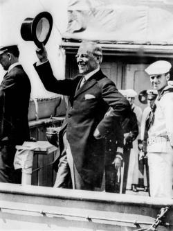 President Woodrow Wilson waves from the deck of the USS George Washington as it steamed into New York Harbor July 9, 1919.