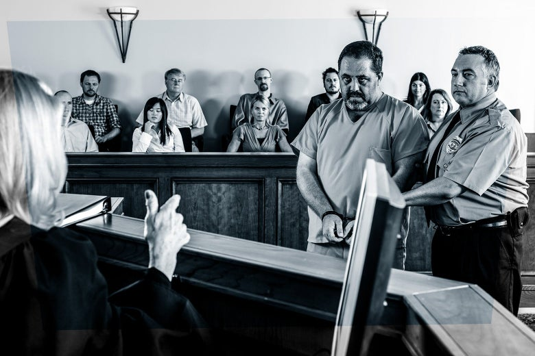 A man in handcuffs gets sentenced as he stands with an officer before a judge in a courtroom. Behind him sits a jury.
