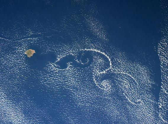 Vortices of clouds swirl as seen from space