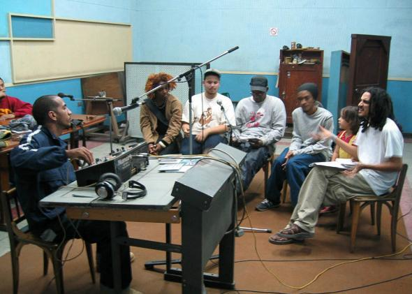 "Ariel Fernandez aka DJ Asho hosting his weekly show ""Microfonazo"" at Radio Pogreso in 2004, with Doble Filo and Obsesion."