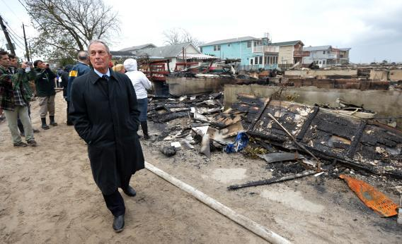 New York City Mayor Michael Bloomberg surveys the damage in Queens after fire destroyed about 80 homes as a result of Hurricane Sandy.