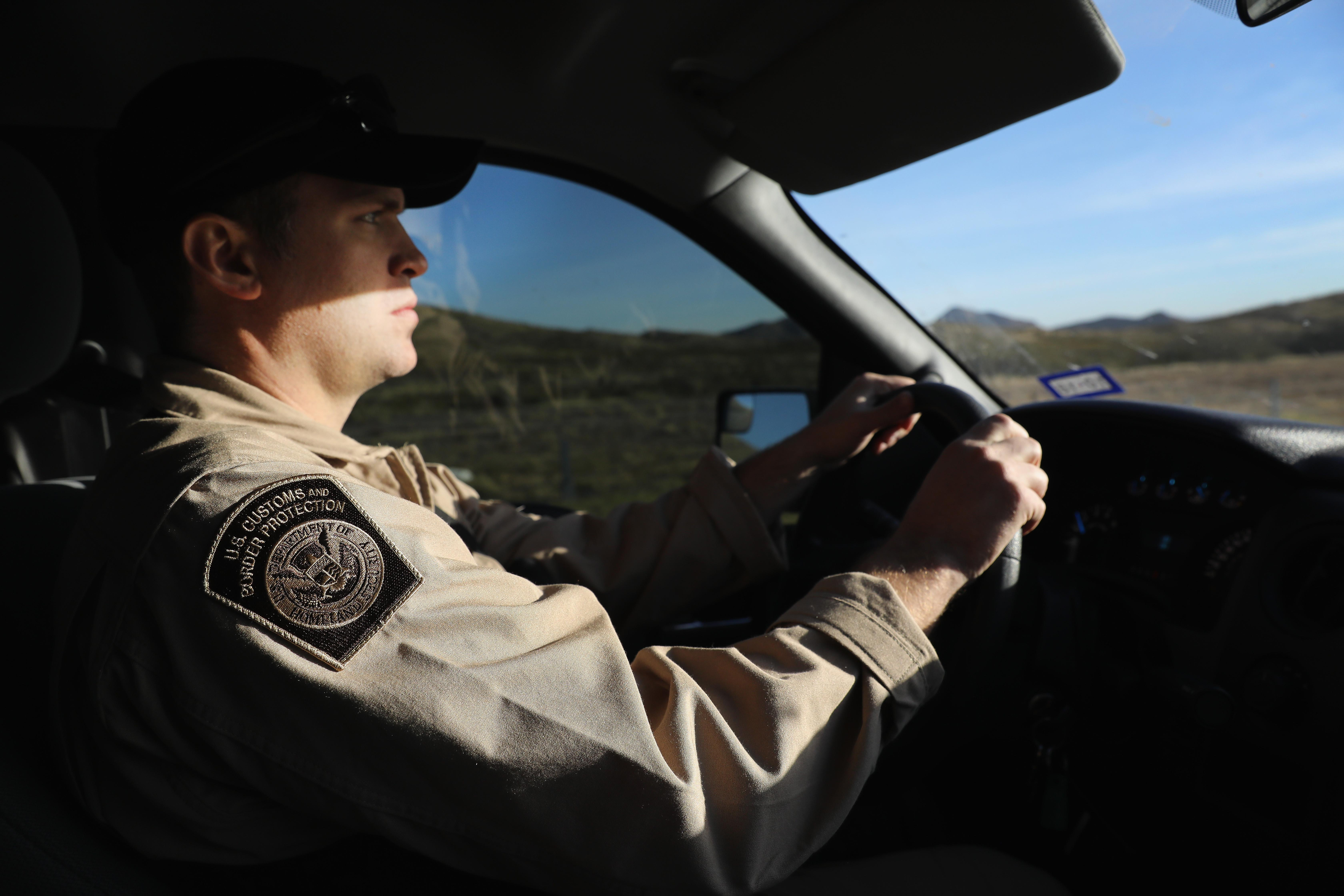 A Customs and Border Protection (CBP) agent drives along Interstate 10 on November 22, 2017 in Van Horn, Texas.
