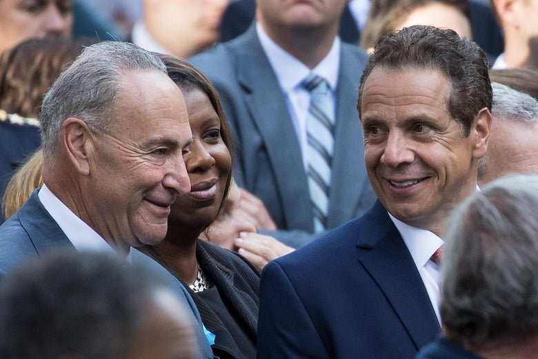 Sen. Chuck Schumer speaks with New York governor Andrew Cuomo during a commemoration ceremony for the victims of the September 11 terrorist attacks at the National September 11 Memorial, September 11, 2017 in New York City.
