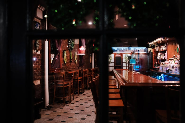 A dark, empty bar sits closed in New York on March 16.