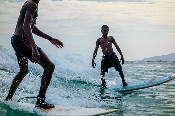 Two of the boys from Surf Haiti dodge share a wave, May 5, 2014.