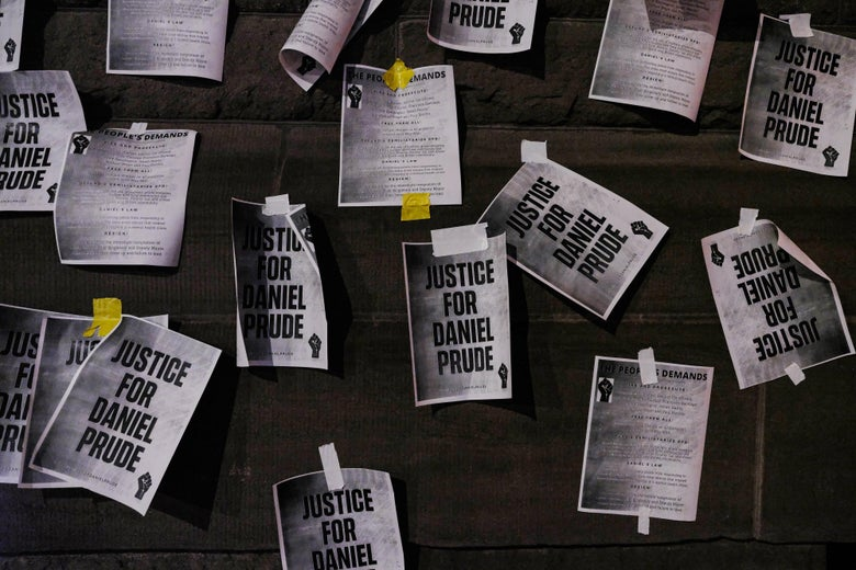 """Papers that say """"Justice for Daniel Prude"""" and list """"The People's Demands,"""" taped to a wall"""