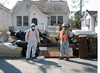 FEMA workers have begun the long task of clearing debris in our neighborhood         Click on image to enlarge.