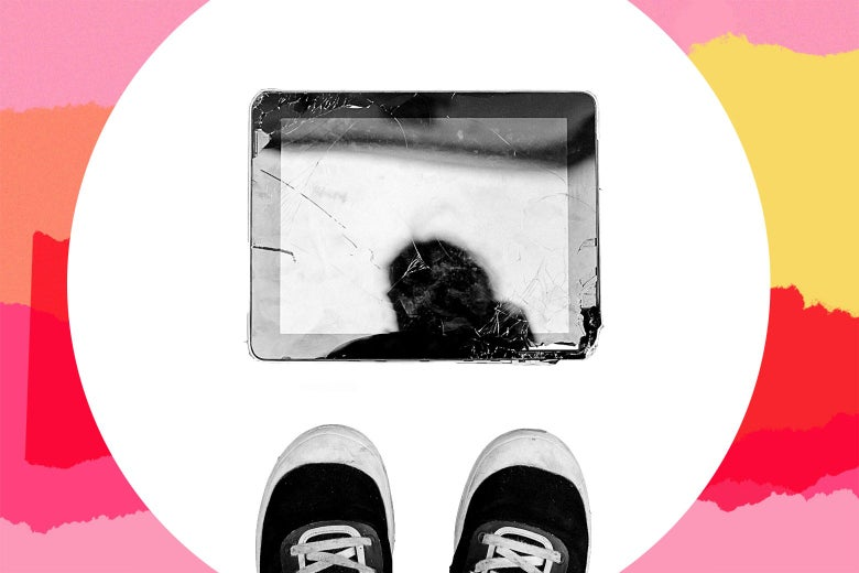 An aerial shot of a kid's sneakers looking down at a broken tablet.