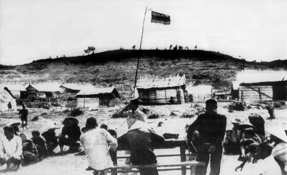Vietnamese flag flying over the village of My Lai.