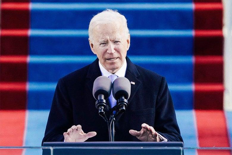 Joe Biden speaks into a microphone.
