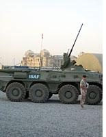 ISAF vehicle with the Darulaman Palace in the background