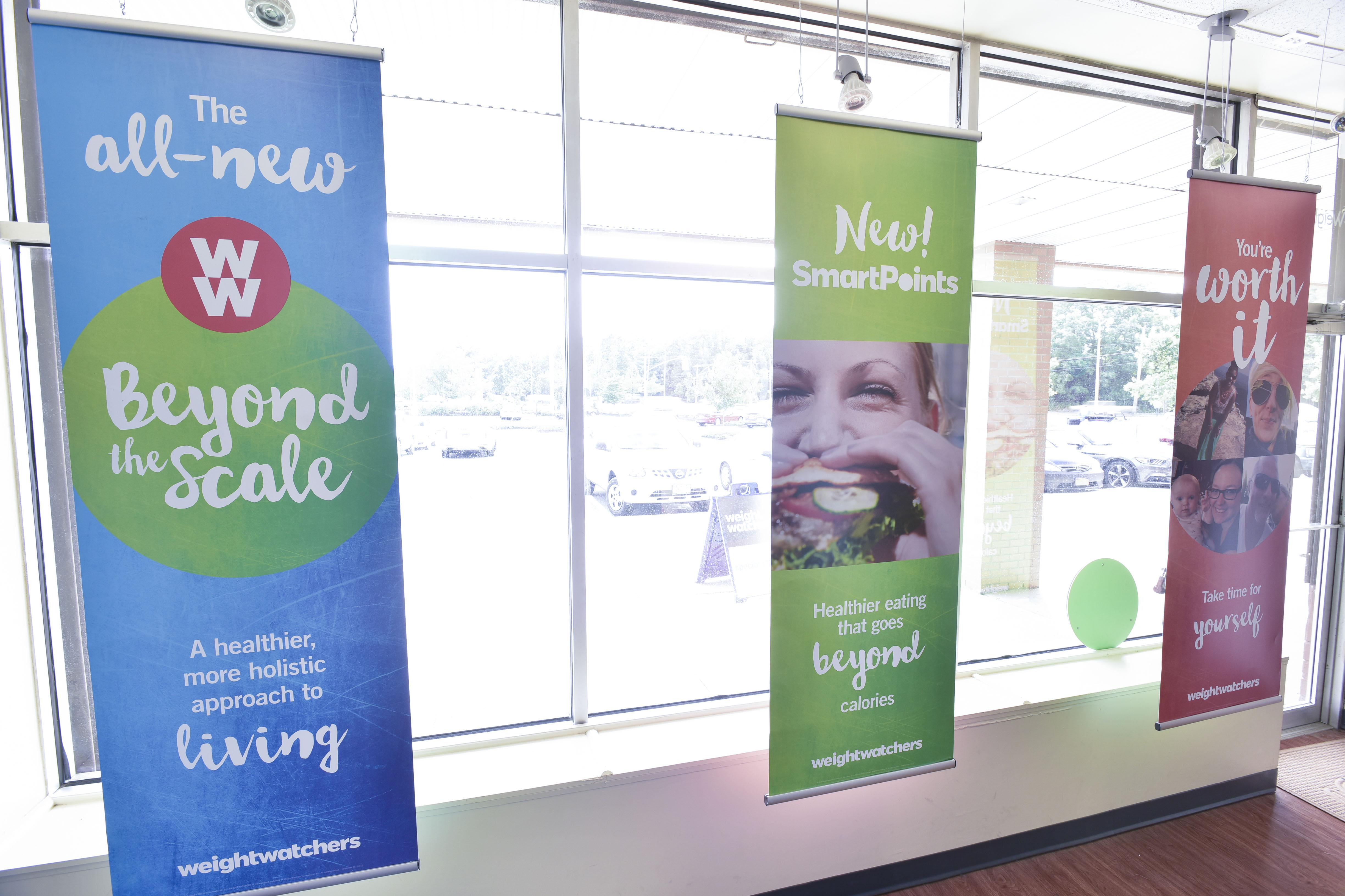 Weight Watchers logo displayed on a wall of windows
