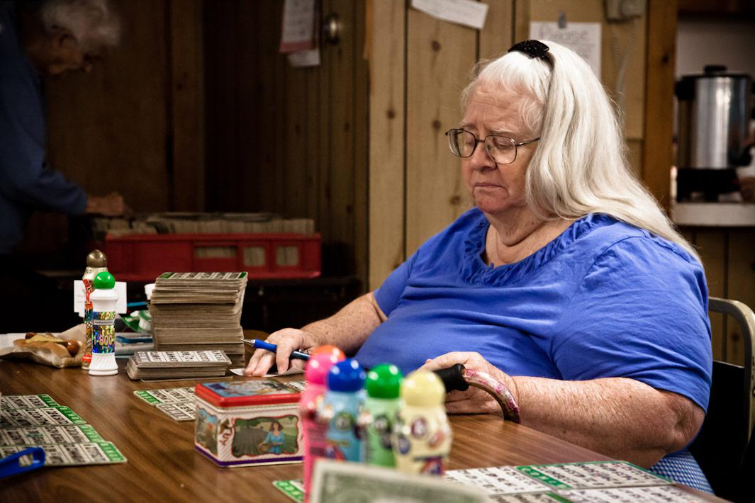 Woman with Bingo Card Stack