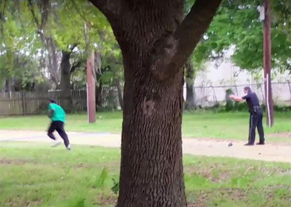 Police officer Michael Slager (right) is seen shooting Walter Scott in the back in this still image from video in North Charleston, South Carolina on April 4, 2015.