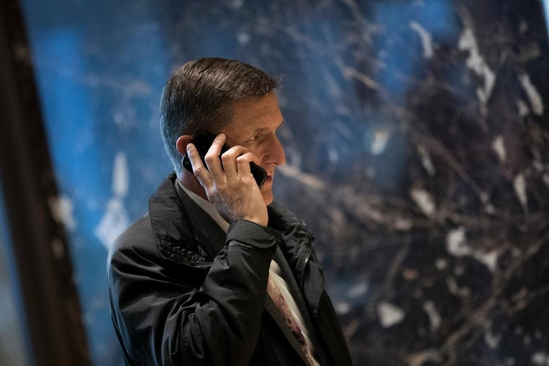 Michael Flynn holds a phone to his ear.