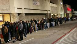 People standing in line for a black friday sale. Click image to expand.