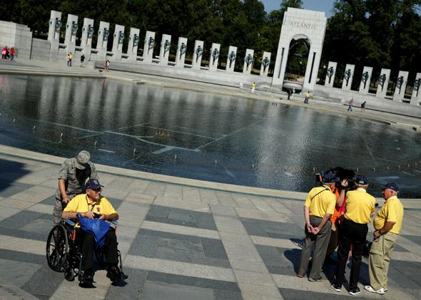 Military veterans visit the World War II Memorial as some of them are interviewed by news media during a government shutdown October 1, 2013 in Washington, DC.