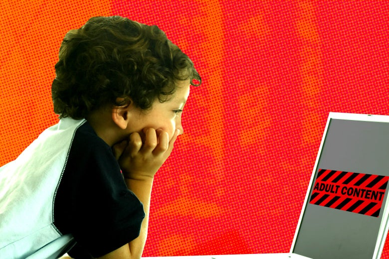 "A little boy looks at a computer screen that shows a sign saying ""Adult Content."""