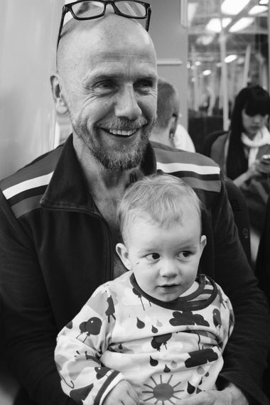 A Swedish father with his child on the Metro.