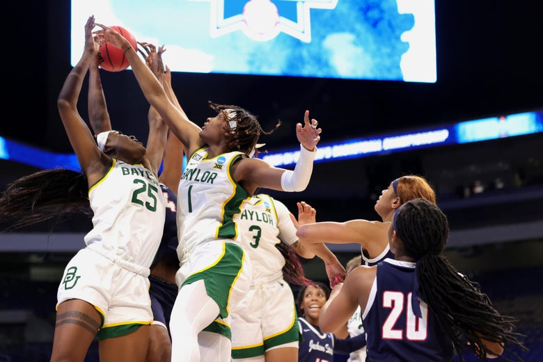 Queen Egbo #25 of the Baylor Lady Bears and NaLyssa Smith #1 go up for a rebound
