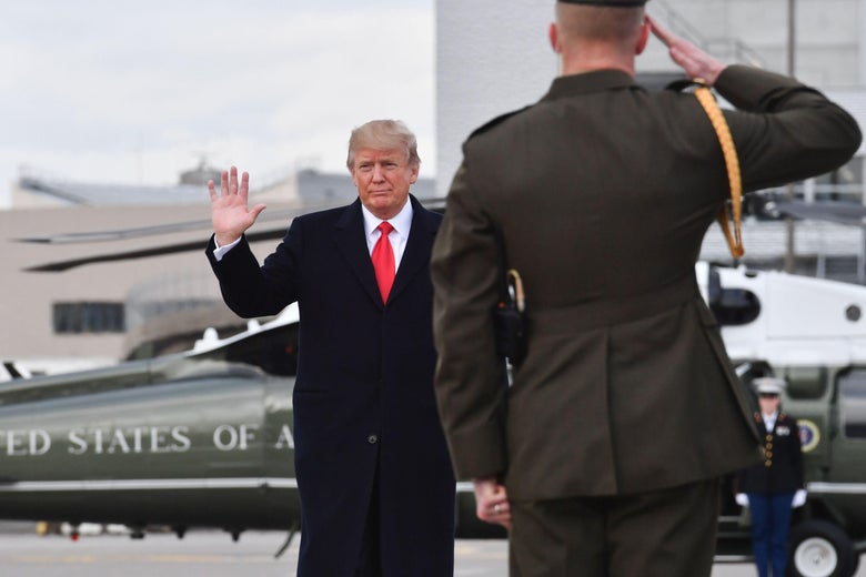 US President Donald Trump waves before boarding the Air Force One ahead of his departure from Zurich Airport in Zurich on January 26, 2018, after attending the World Economic Forum (WEF) annual meeting in Davos. / AFP PHOTO / Nicholas Kamm        (Photo credit should read NICHOLAS KAMM/AFP/Getty Images)