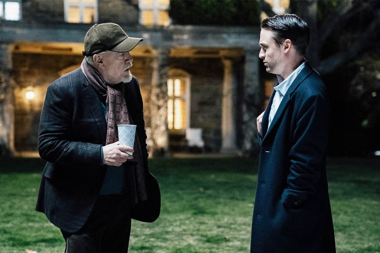 Brian Cox and Kieran Culkin stand on a lawn outside a big house in a still from Succession.
