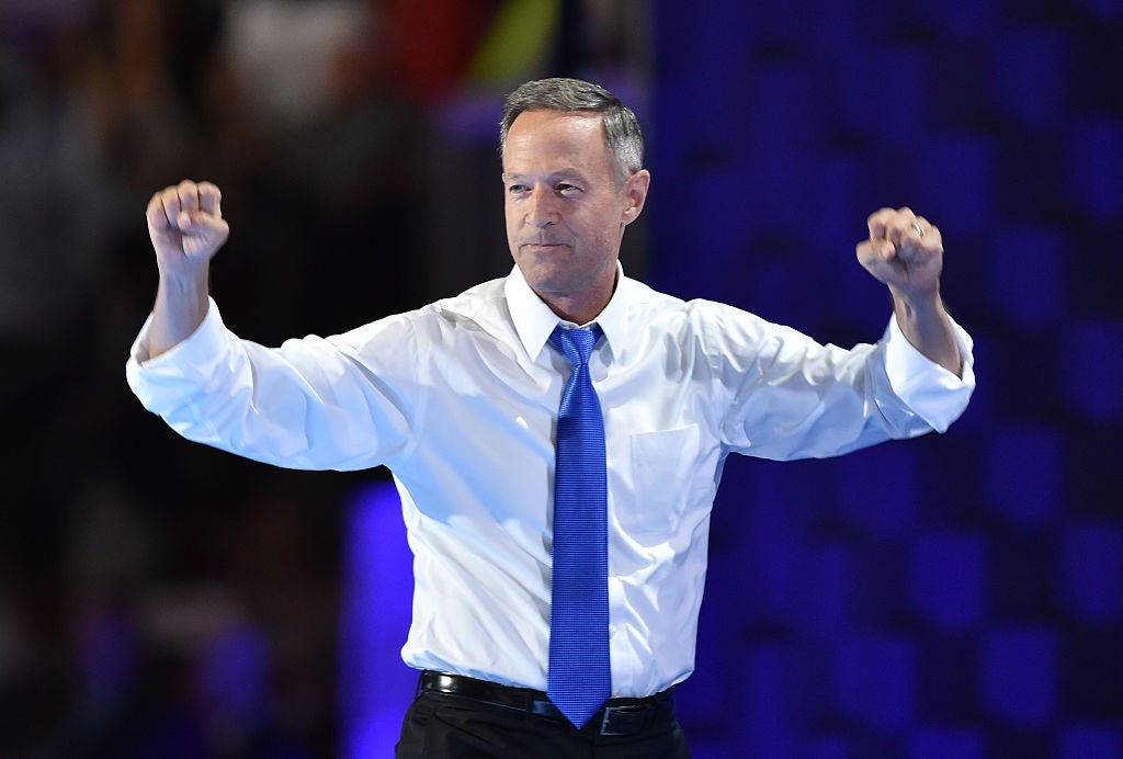 Martin O'Malley, in shirtsleeves and a purple tie, pumps his fists.