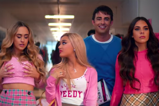 "Screenshot of the part in the video where the ""Plastics"" are walking down the school hallway, as in Mean Girls"