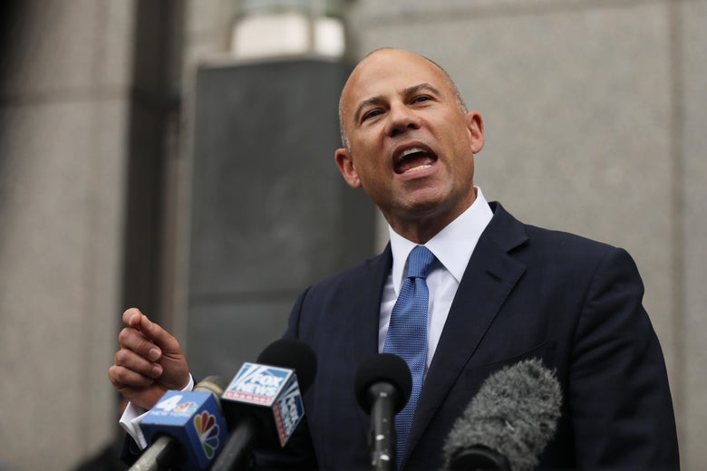 Avenatti points as he speaks into microphones outside of a New York courthouse.