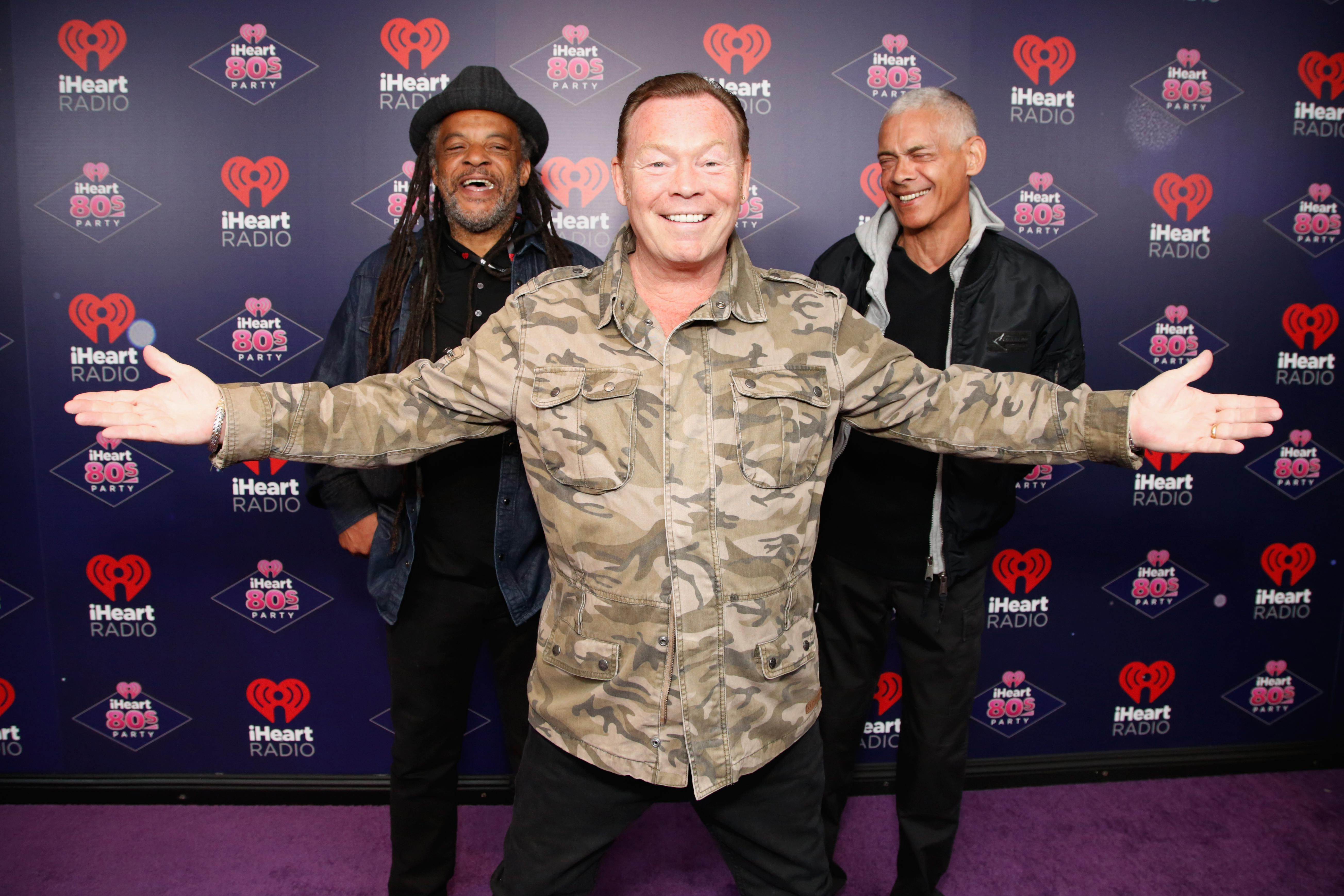 Astro, Ali Campbell, and Mickey Virtue, looking happy.