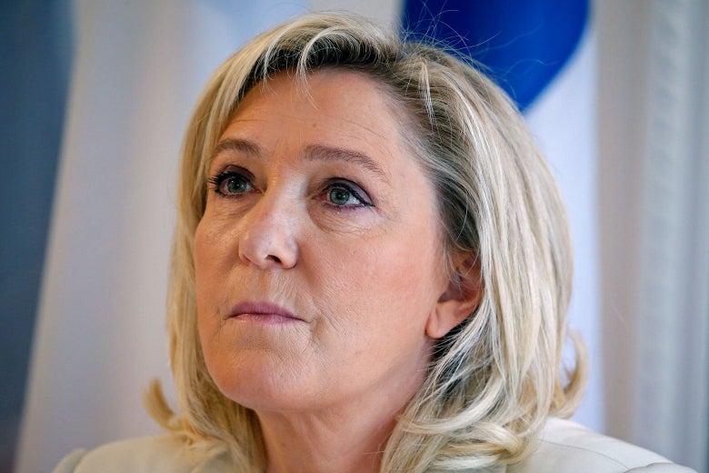 Close-up on Le Pen looking upward