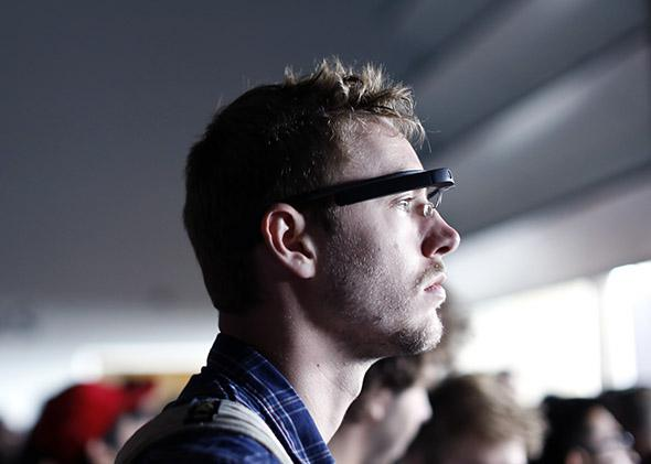 An attendee wears a Google Glass