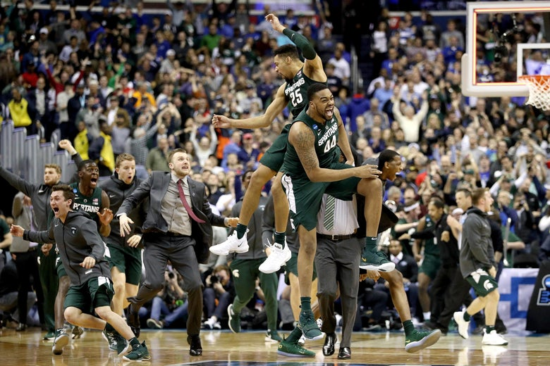 Nick Ward and Kenny Goins of the Michigan State Spartans celebrate their team's 68-67 win over the Duke Blue Devils in the East Regional game of the 2019 NCAA Men's Basketball Tournament.