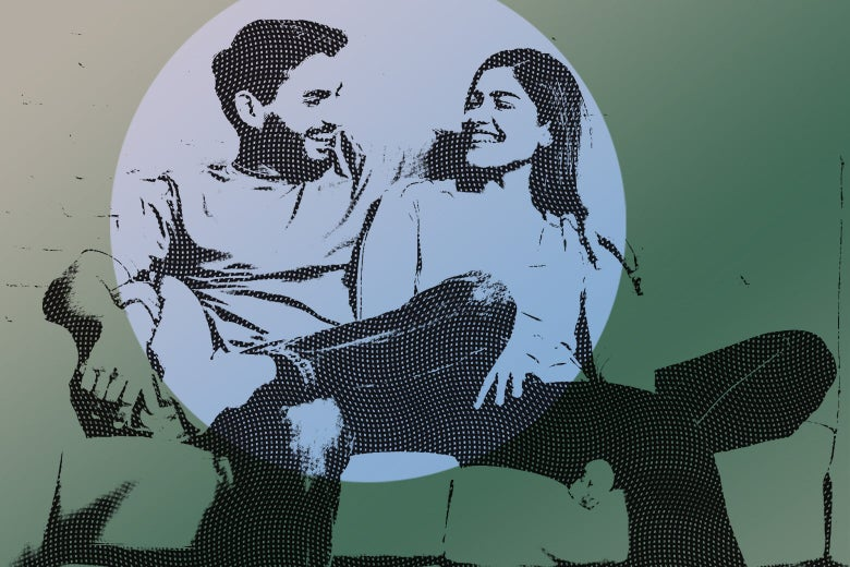 smiling man and woman sitting on couch