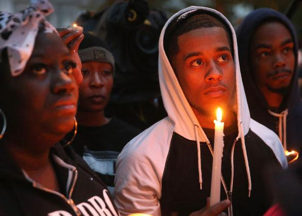 Mourners attend a candlelight vigil in memory of 18-year-old Vonderrit Myers Jr. on October 9, 2014 in St Louis, Missouri.