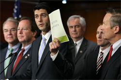 U.S. Rep. Paul Ryan holds a copy of the 2012 Republican budget proposal. Click image to expand.
