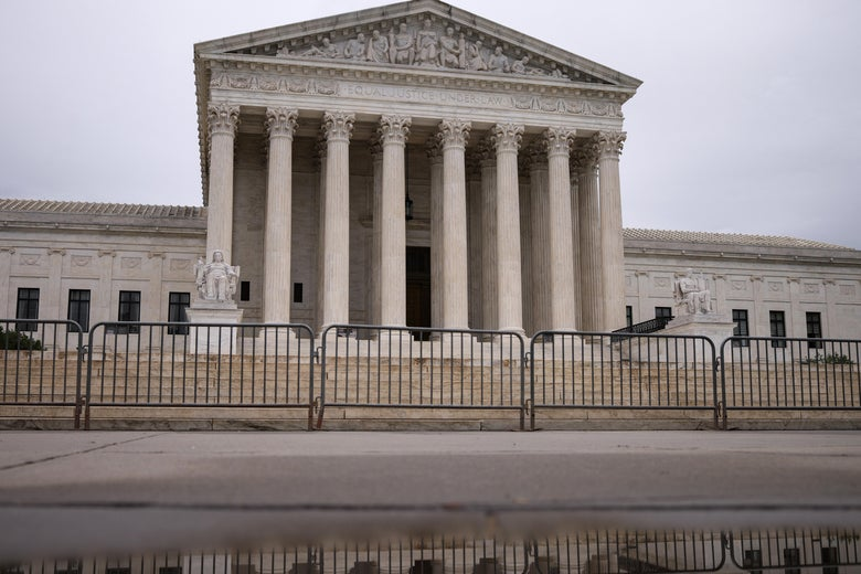 Barriers are seen in front of the Supreme Court.