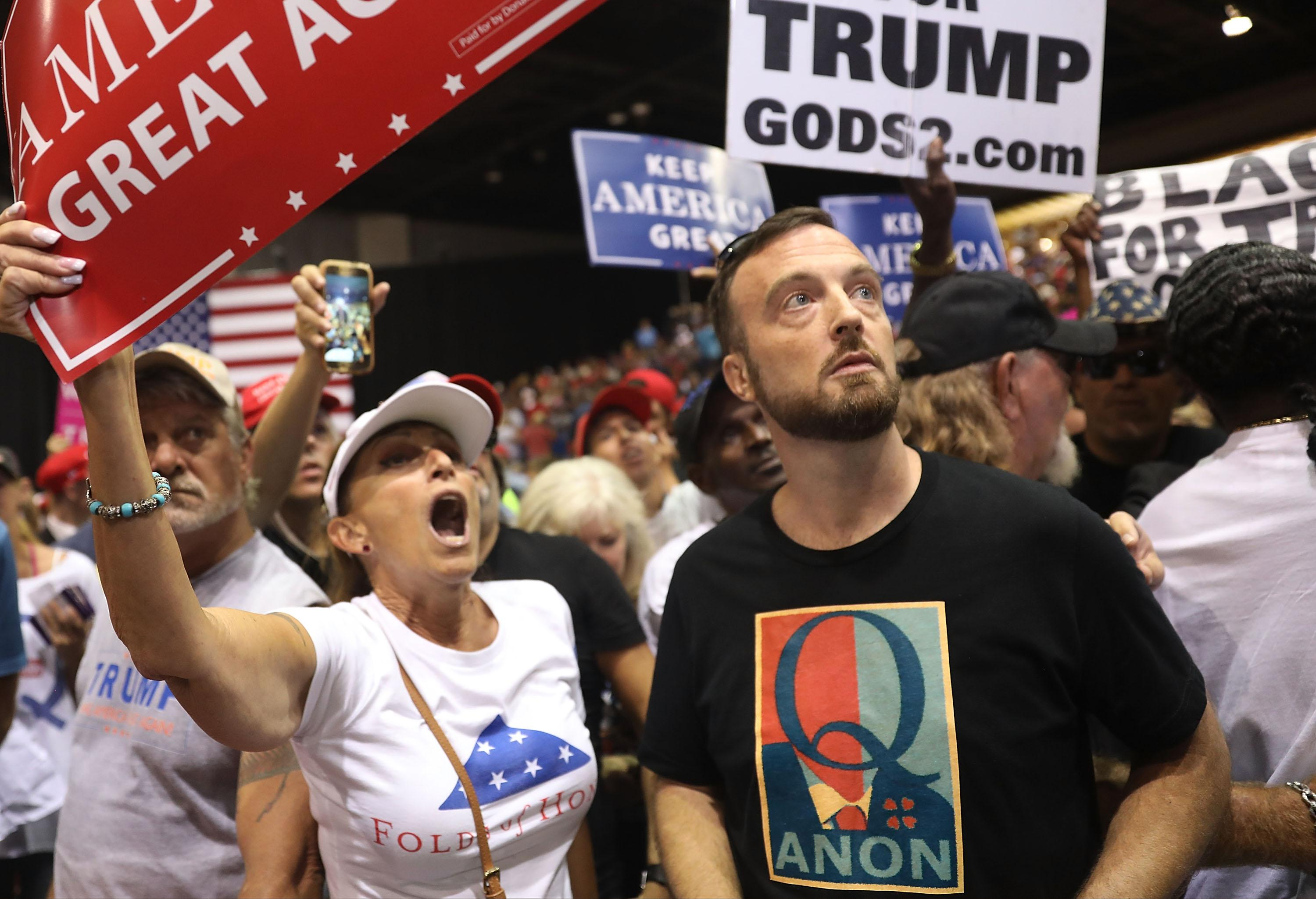 TAMPA, FL - JULY 31:  A man wear a shirt with the words Q Anon as he attends a rally for President Donald Trump at the Make America Great Again Rally being held in the Florida State Fair Grounds Expo Hall on July 31, 2018 in Tampa, Florida.  Some people attending either wore shirts with a Q or held signs with a Q and are reported to be part of a conspiracy theory group.  (Photo by Joe Raedle/Getty Images)