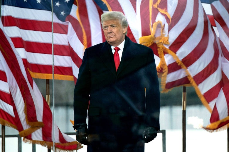 Donald Trump in front of the White House and several U.S. flags.