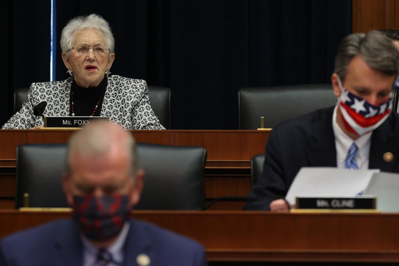 Three representatives seated in a hearing room, two wearing masks while Foxx does not