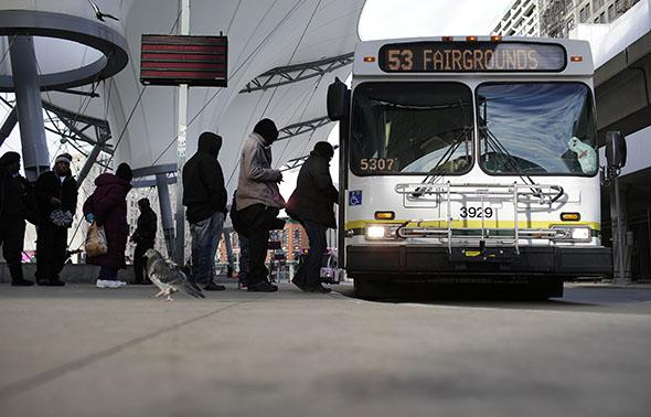 Commuters board the 53 Woodward bus at the Rosa Parks bus terminal January 1, 2015 in Detroit, Michigan.