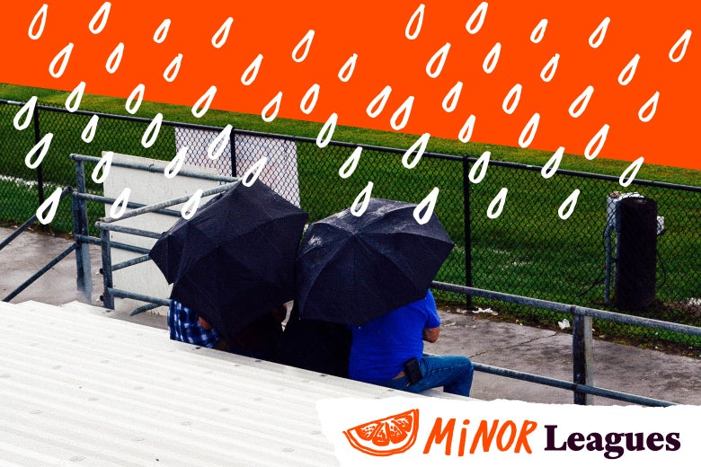 Parents sitting in the rain watching youth sports.