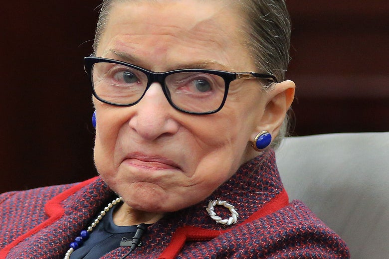 A close-up of Ruth Bader Ginsburg with a slight, close-mouthed smile.