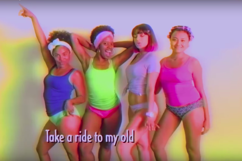 Four women dance in tank tops and underwear.