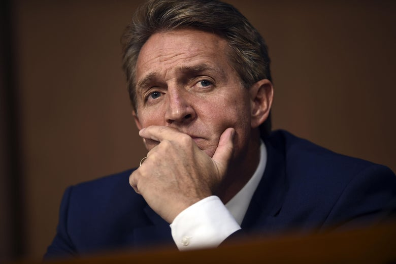 Sen. Jeff Flake listens on Tuesday during day one of Brett Kavanaugh's confirmation hearing to be on the U.S. Supreme Court.
